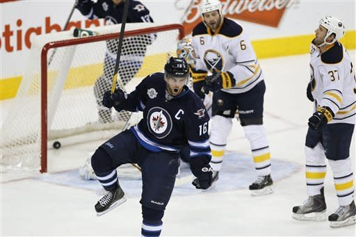 Winnipeg Jets' Andrew Ladd (16) celebrates their first goal against the Buffalo Sabres during first-period NHL hockey game action in Winnipeg, Manitoba, Thursday, Jan. 19, 2012. (AP Photo/The Canadian Press, John Woods)