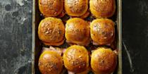 """<p><span class=""""redactor-invisible-space""""><span class=""""redactor-invisible-space"""">Flaky buns filled with sharp cheddar cheese and smoked ham, now we're talking.</span></span></p><p><span class=""""redactor-invisible-space""""><span class=""""redactor-invisible-space""""><a href=""""https://www.goodhousekeeping.com/food-recipes/a42211/ham-and-cheese-oven-sliders-recipe/"""" rel=""""nofollow noopener"""" target=""""_blank"""" data-ylk=""""slk:Get the recipe for Ham and Cheese Oven Sliders »"""" class=""""link rapid-noclick-resp""""><em>Get the recipe for Ham and Cheese Oven Sliders »</em></a></span></span><br></p>"""