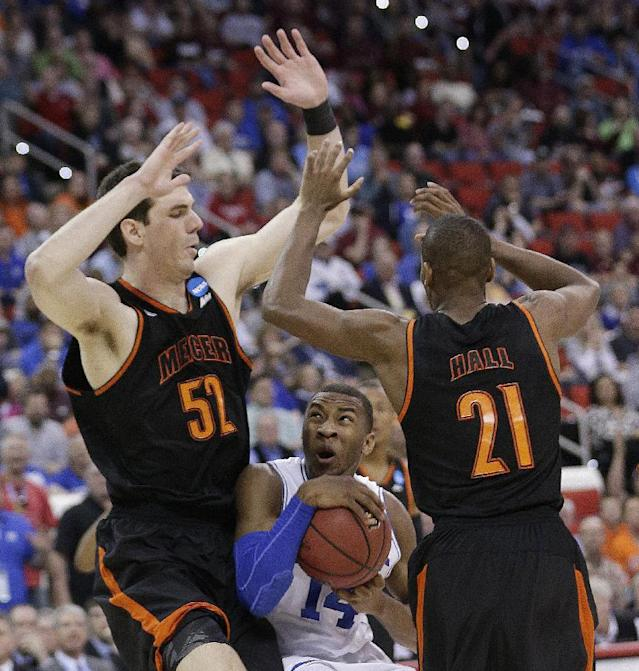 Duke guard Rasheed Sulaimon (14) works between Mercer's Daniel Coursey (52) and Langston Hall (21)during the second half of an NCAA college basketball second-round game, Friday, March 21, 2014, in Raleigh, N.C