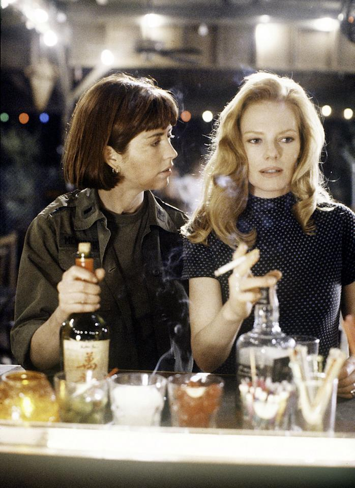 """""""Phoenix"""" - Season Three - 3/21/90K.C. (Marg Helgenberger, right) needed McMurphy (Dana Delany) to vouch for her innocence after K.C. became involved in the middle of a C.I.A. assassination plot."""
