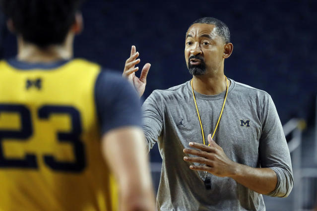 FILE - In this Thursday, Oct. 17, 2019, file photo, Michigan head coach Juwan Howard directs his team during NCAA college basketball practice in Ann Arbor, Mich. Howard took over his former team when he replaced John Beilein at Michigan. (AP Photo/Carlos Osorio, File)