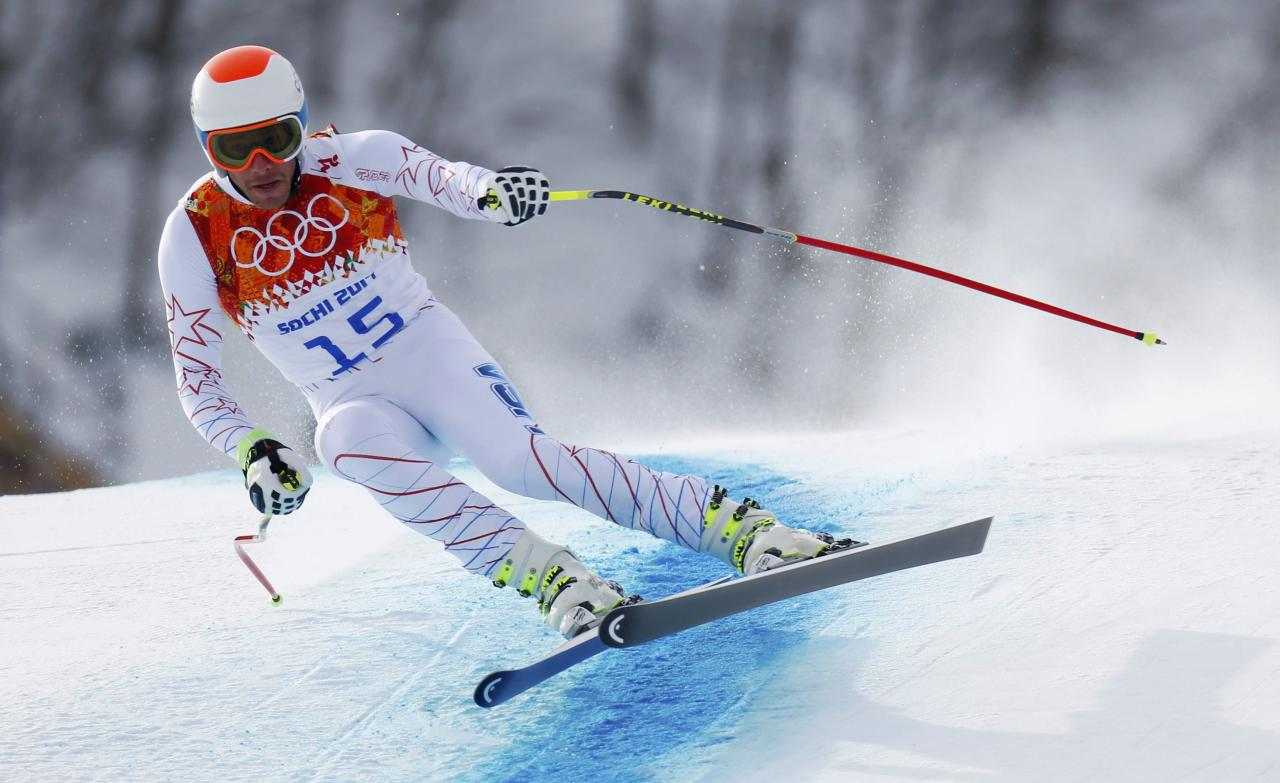 Bode Miller of the U.S. skis in the men's alpine skiing downhill race during the 2014 Sochi Winter Olympics at the Rosa Khutor Alpine Center February 9, 2014. REUTERS/Dominic Ebenbichler (RUSSIA - Tags: SPORT SKIING OLYMPICS)