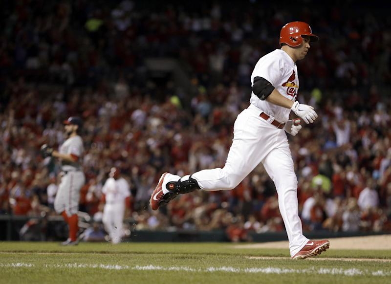 St. Louis Cardinals' Carlos Beltran, right, rounds the bases after hitting a two-run home run off Washington Nationals starting pitcher Tanner Roark during the fifth inning of a baseball game Monday, Sept. 23, 2013, in St. Louis. (AP Photo/Jeff Roberson)