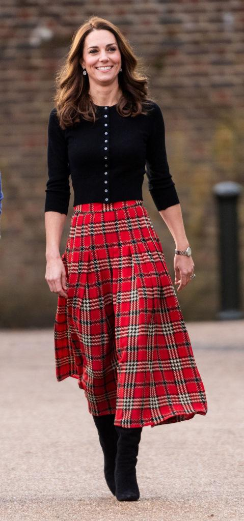 68ea194622 View photos. Kate Middleton wears a black cardigan and red tartan skirt by Emilia  Wickstead ...