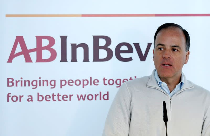 Anheuser-Busch InBev CFO Dutra presents the company's results during a news conference in Leuven