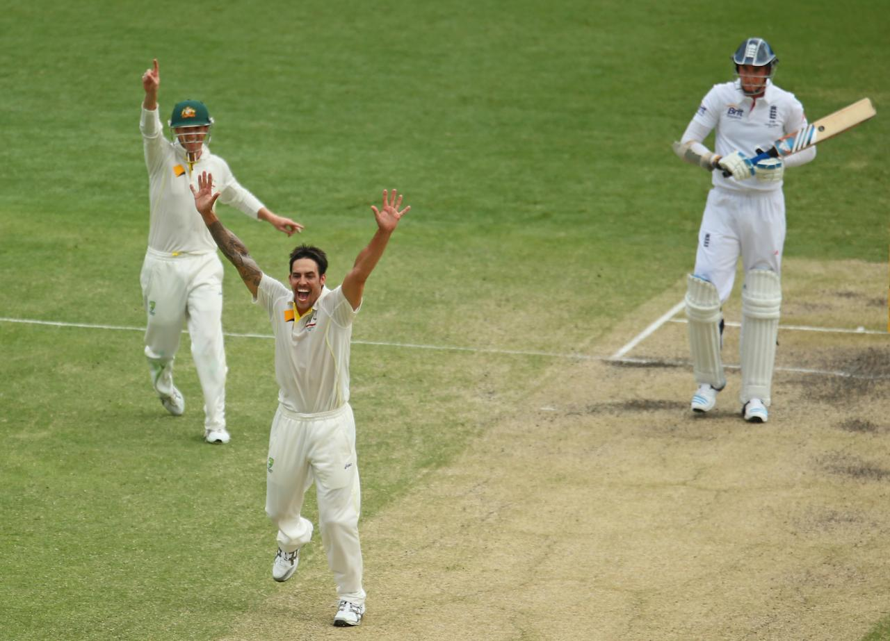BRISBANE, AUSTRALIA - NOVEMBER 24:  Mitchell Johnson of Australia appeals successfully for the wicket of Stuart Broad of England during day four of the First Ashes Test match between Australia and England at The Gabba on November 24, 2013 in Brisbane, Australia.  (Photo by Scott Barbour/Getty Images)