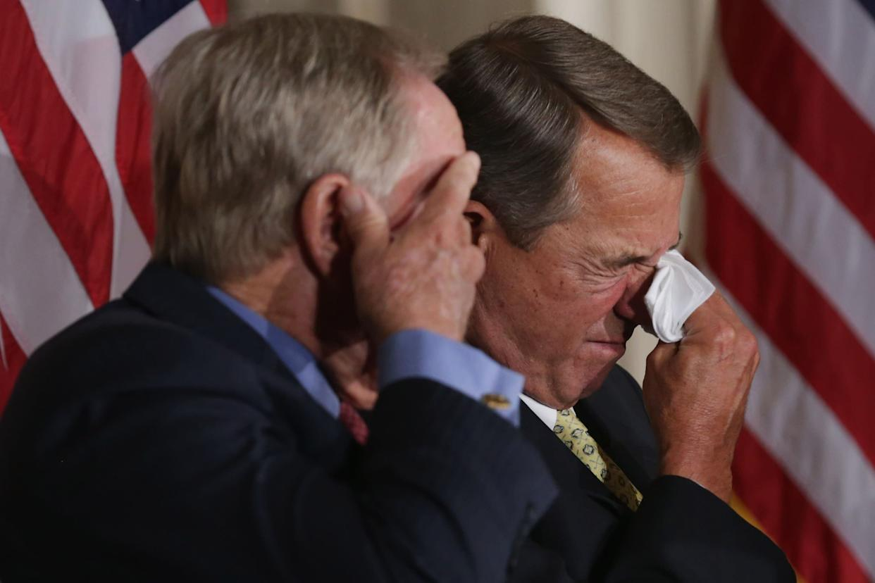 Golf legend Jack Nicklaus, left, and Speaker of the House John Boehner (R-Ohio) wipe away tears after listening to the remarks of Nicklaus' son Jack Nicklaus II during the elder Nicklaus' Congressional Gold Medal ceremony in the U.S. Capitol Rotunda on March 24, 2015. Nicklaus was lauded by family, friends and politicians for his many sports achievements and his philanthropy.