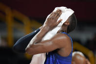 United States' Bam Adebayo reacts at the end of a men's basketball preliminary round game against France at the 2020 Summer Olympics, Sunday, July 25, 2021, in Saitama, Japan. France won 83-76. (AP Photo/Charlie Neibergall)