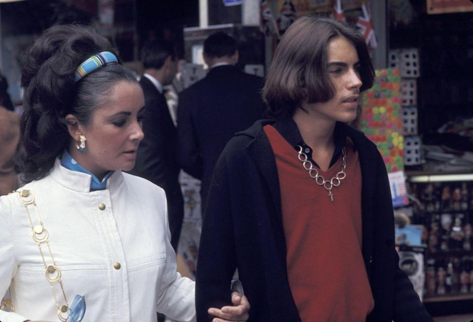 <p>Elizabeth and her eldest son, Michael, are seen walking arm in arm. Throughout her many turbulent marriages, the actress always remained a loving and present mother to her four children. </p>
