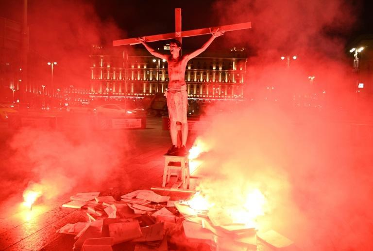 activists attached a half-naked Pavel Krisevich to a cross and put him on a stool in front of the headquarters of the Federal Security Service (FSB)