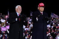 President Donald Trump and Vice President Mike Pence smile after a campaign rally at Gerald R. Ford International Airport, early Tuesday, Nov. 3, 2020, in Grand Rapids, Mich. (AP Photo/Evan Vucci)