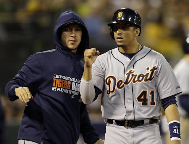 Detroit Tigers Victor Martinez (41) celebrates after scoring in the sixth inning of Game 5 of an American League baseball division series against the Oakland Athletics in Oakland, Calif., Thursday, Oct. 10, 2013. (AP Photo/Ben Margot)