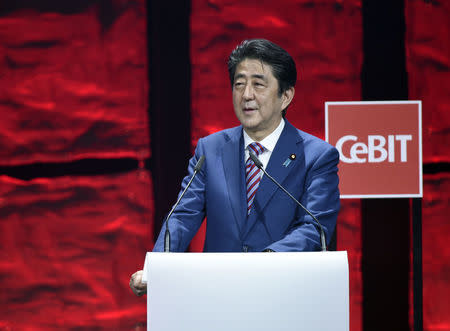 Japanese Prime Minister Shinzo Abe speaks during the opening ceremony of the CeBit computer fair in Hanover