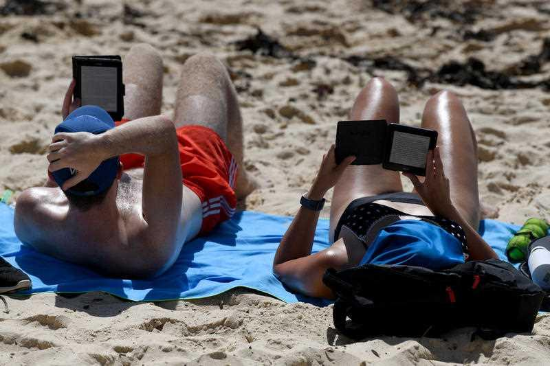 Beachgoers are seen at Coogee Beach during hot weather in Sydney.