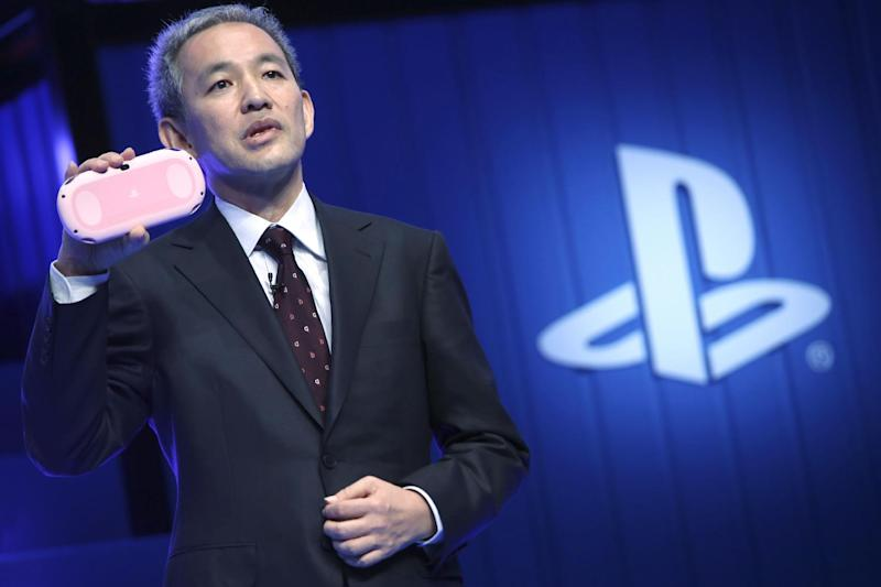 "Sony Computer Entertainment Japan and Asia (SCEJA) President Atsushi Morita reveals a ""Light Pink/White"" model of the PlayStation Vita during SCEJA press conference in Tokyo, Monday, Sept. 1, 2014. (AP Photo/Eugene Hoshiko)"