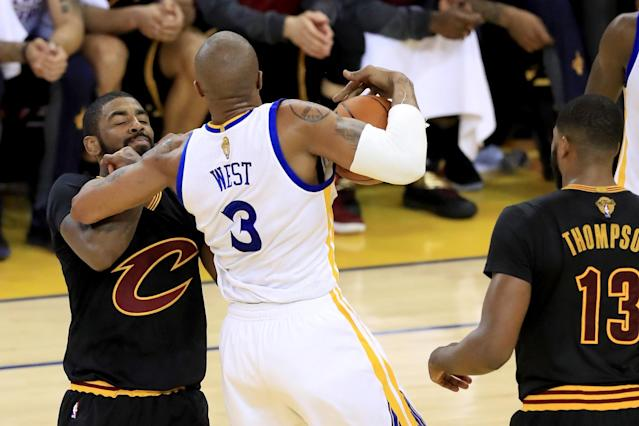 <p>David West #3 of the Golden State Warriors commits a foul on Kyrie Irving #2 of the Cleveland Cavaliers in Game 5 of the 2017 NBA Finals at ORACLE Arena on June 12, 2017 in Oakland, California. </p>