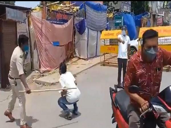 Visual from the viral video in which Basant Khalkho is seen beating a man. (Photo/ANI)