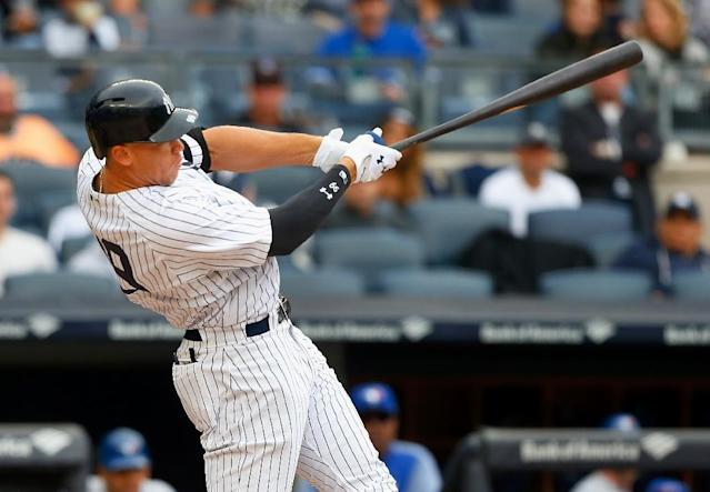 Aaron Judge of the New York Yankees follow through on a fourth inning home run against the Toronto Blue Jays, at Yankee Stadium in New York, on September 30, 2017 (AFP Photo/Jim McIsaac)