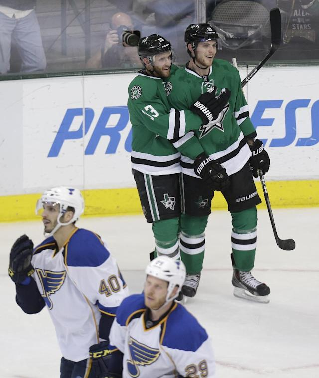 Dallas Stars center Tyler Seguin (91) celebrates his goal with Alex Goligoski (33) as St. Louis Blues' Maxim Lapierre (40) andSteve Ott (29) skate away during the second period of an NHL hockey game Friday, April 11, 2014, in Dallas. (AP Photo/LM Otero)