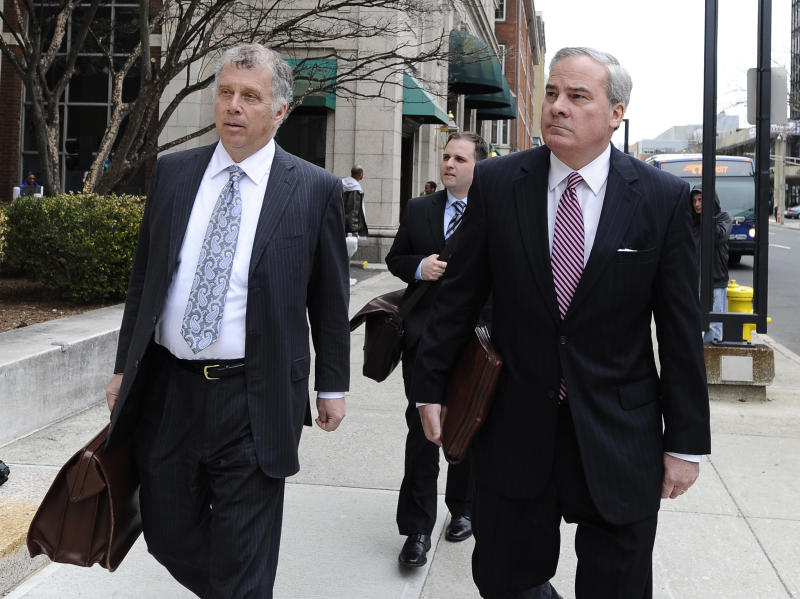 Former Connecticut Gov. John G. Rowland, right, arrives with attorney Reid Weingarten at federal court, Friday, April 11, 2014, in New Haven, Conn. A grand jury on Thursday returned a seven-count indictment alleging Rowland schemed to conceal involvement with congressional campaigns. (AP Photo/Jessica Hill)