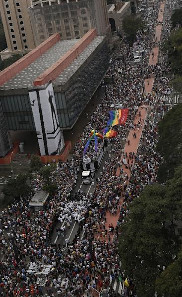 Revellers take part in the annual Gay Pride Parade in Sao Paulo, Brazil on June 7, 2015 (AFP Photo/Miguel Schincariol)