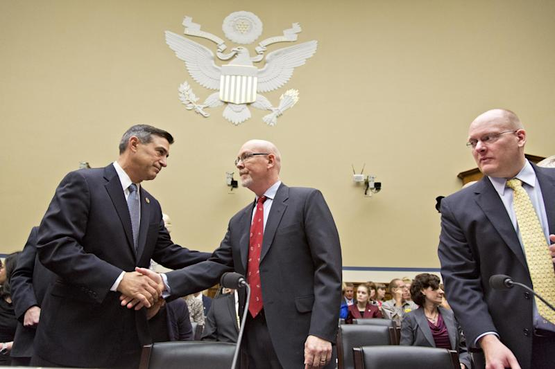 FILE – In this May 8, 2013, file photo House Oversight Committee Chairman Darrell Issa, R-Calif., left, welcomes Gregory Hicks, former deputy chief of mission in Libya, number two in rank to slain U.S. Ambassador Christopher Stevens, as he Hicks arrives to testify about last year's deadly assault on the U.S. diplomatic mission in Benghazi, Libya, on Capitol Hill in Washington. At right is Eric Nordstrom, the State Department's former regional security officer in Libya. Congressional Republicans are looking for evidence of incompetence and cover-up in the ashes of the Sept. 11 anniversary attack. (AP Photo/J. Scott Applewhite, File)