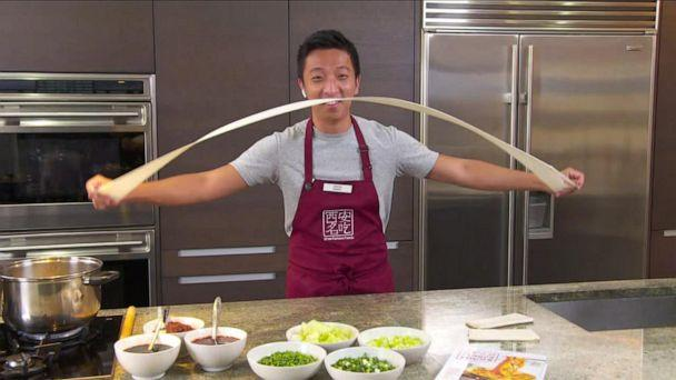 PHOTO: Jason Wang demonstrates how to make hand-pulled noodles from Xi'an Famous Foods in New York City. (ABC News)