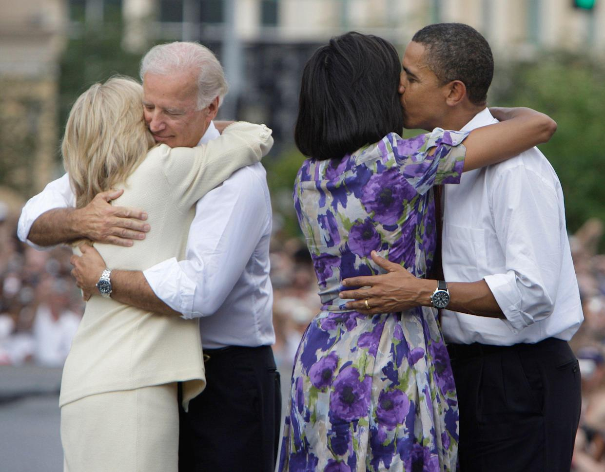 Then presidential candidate Sen. Barack Obama and his running mate Sen. Joe Biden with their wives Michelle Obama and Jill Biden at a campaign stop Springfield, Ill., August 2008. (Photo: M. Spencer Green/AP)