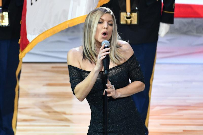 "People on social media were not impressed with Fergie's rendition of ""The Star-Spangled Banner"" Sunday night. (Allen Berezovsky via Getty Images)"