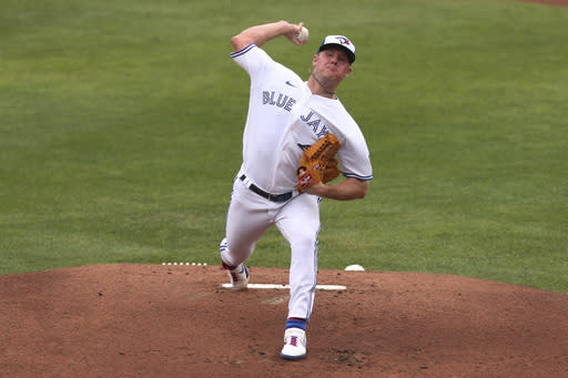 Toronto Blue Jays starting pitcher Chase Anderson throws to Tampa Bay Rays' Yandy Diaz during the first inning of a baseball game, Saturday, Aug. 15, 2020, in Buffalo, N.Y. (AP Photo/Jeffrey T. Barnes)