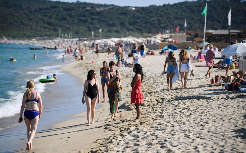 People enjoy Pampelonne beach after France eased lockdown restrictions - but it is now on the new 'amber plus' list - AFP