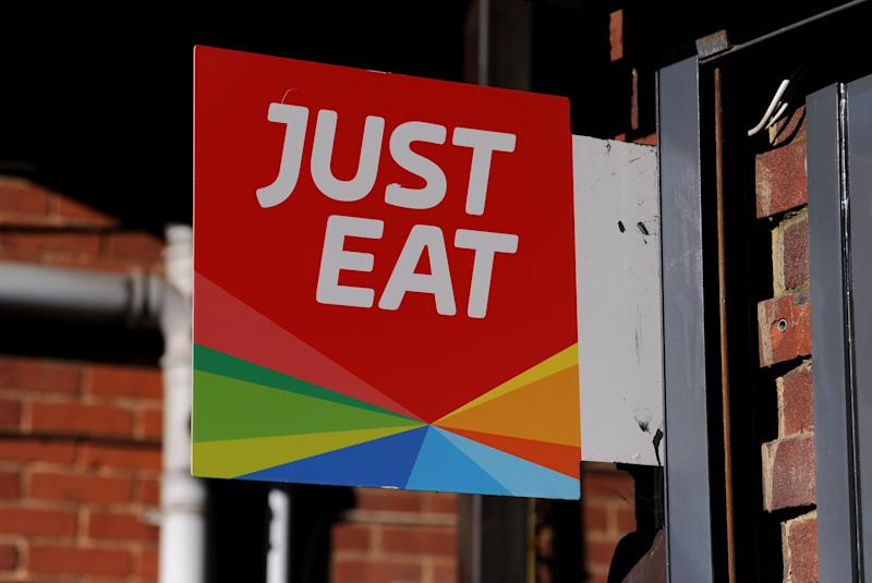 FLEET, ENGLAND - MAY 19: A detailed view of a Just Eat sign displayed at the front of a pizza takeaway shop on May 19, 2020 in Fleet, England. The British government has started easing the lockdown it imposed two months ago to curb the spread of Covid-19, abandoning its 'stay at home' slogan in favour of a message to 'be alert', but UK countries have varied in their approaches to relaxing quarantine measures. (Photo by Alex Burstow/Getty Images)