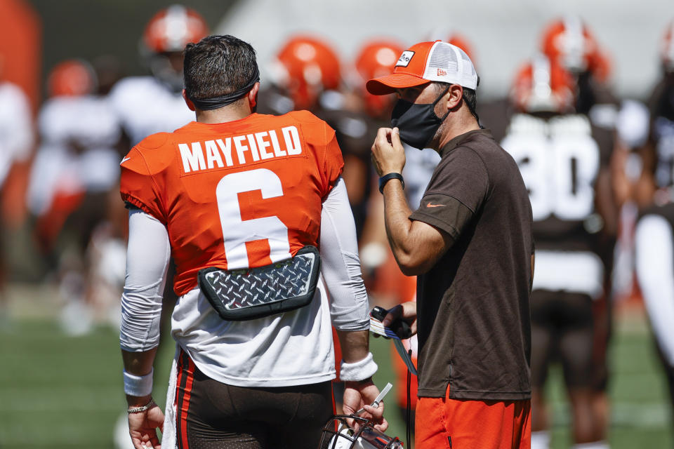 Under new head coach Kevin Stefanski (R), Baker Mayfield and the Cleveland Browns have been much less talkative this offseason. (AP Photo/Ron Schwane, File)