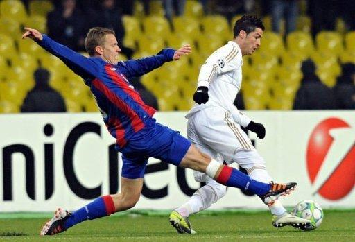 Cristiano Ronaldo (R) of Real Madrid fights for the ball against Pontus Wernbloom (L) of CSKA Moscow during their round of 16, first leg match UEFA Champions League in Moscow. The match ended in a 1-1 draw