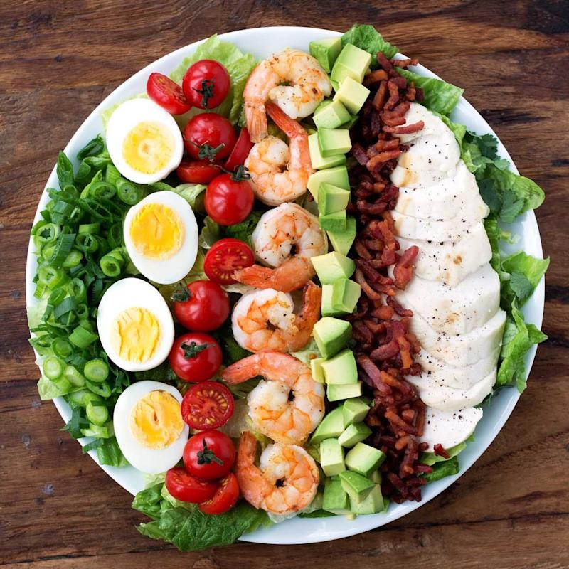 """<strong>Get the <a href=""""http://kitscoastal.com/coastal-cobb-salad/"""" target=""""_blank"""" rel=""""noopener noreferrer"""">Coastal Cobb Salad With Creamy Cilantro Lemon Dressing</a> recipe from Kit&rsquo;s Coastal.</strong>"""