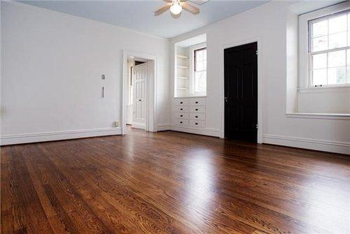 With the floors refurbished and the paint fresh, this room gives a peek into the possibility this home offers for Reese.  Source: Zillow