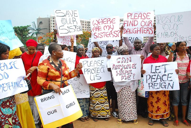 Former Nigerian Education Minister and Vice-President of the World Bank's Africa division (3rd L) Obiageli Ezekwesilieze leads a march of Nigeria women and mothers of the kidnapped girls of Chibok, in Abuja, on April 30, 2014 (AFP Photo/Philip Ojisua)