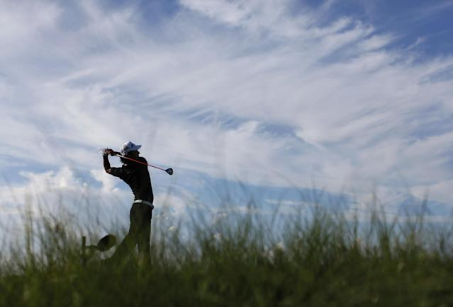 Ryo Ishikawa of Japan watches his tee shot on the 11th hole during the first round for the PGA Championship golf tournament on the Ocean Course of the Kiawah Island Golf Resort, Thursday, Aug. 9, 2012, in Kiawah Island, S.C. (AP Photo/Evan Vucci)
