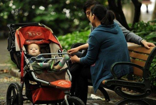 A mother and father with their baby in a park in Shanghai. Placentophagy -- the practice of eating one's placenta after birth -- is relatively common in China, where it is thought to have anti-ageing properties, and dates back more than 2,000 years