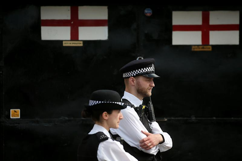 Police officers stand on duty outside St. Thomas' Hospital in central London on April 7, where British Prime Minister Boris Johnson is in intensive care with coronavirus symptoms.