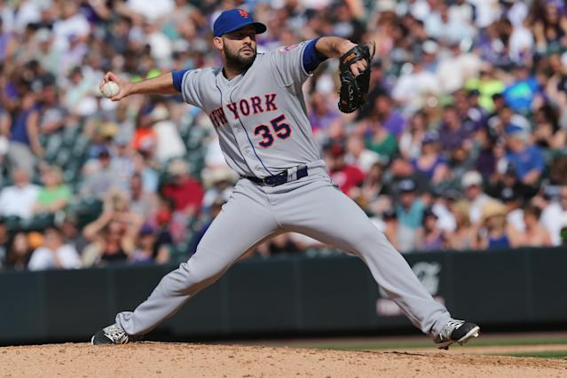 New York Mets starting pitcher Dillon Gee works against the Colorado Rockies in the seventh inning of the Mets' 5-1 victory in a baseball game in Denver, Sunday, May 4, 2014. (AP Photo/David Zalubowski)