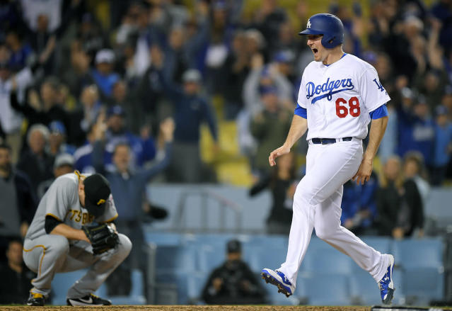 <p>Los Angeles Dodgers' Ross Stripling, right, scores the winning run on a walk off double by Austin Barnes as Pittsburgh Pirates relief pitcher Daniel Hudson crouches at home during the 10th inning of a baseball game, May 9, 2017, in Los Angeles. (Photo: Mark J. Terrill/AP) </p>