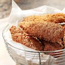 """<p>These crispy chicken """"wings,"""" made with boneless, skinless chicken breast tenders, stay crispy with only a light coating of oil--no deep-frying needed. Serve as an appetizer or try them for dinner with crunchy vegetables and dip on the side.</p>"""