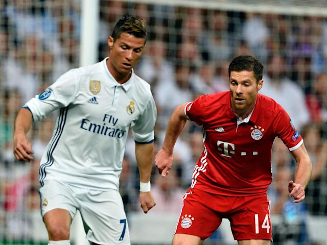 Cristiano Ronaldo comes up against former team-mate Xabi Alonso: Getty