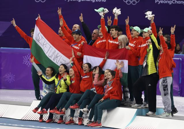 Short Track Speed Skating Events - Pyeongchang 2018 Winter Olympics - Men's 5000m Relay Final - Gangneung Ice Arena - Gangneung, South Korea - February 22, 2018 - Gold medallists Viktor Knoch, Csaba Burjan, Liu Shaoang and Sandor Liu Shaolin of Hungary pose with members of Team Hungary and short track speed skater Elise Christie of Britain. REUTERS/Lucy Nicholson