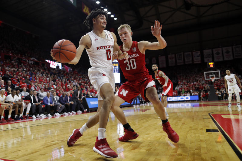 Rutgers guard Geo Baker (0) looks to pass around Nebraska guard Charlie Easley (30) during the second half of an NCAA college basketball game Saturday, Jan. 25, 2020, in Piscataway, N.J. Rutgers won 75-72. (AP Photo/Adam Hunger)