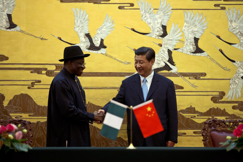 Chinese President Xi Jinping, right, shakes hands with Nigerian President Goodluck Jonathan, left, after the two country's ministers signed several agreements during a signing ceremony at the Great Hall of the People in Beijing, China, Wednesday, July 10, 2013. (AP Photo/Alexander F. Yuan)