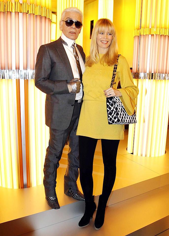 """Chanel designer Karl Lagerfeld took a strategic step up from a towering Claudia Schiffer at his couture show. With her burgeoning baby bump hidden under a loose sunflower top, Schiffer looked amazing. Eric Ryan/<a href=""""http://www.gettyimages.com/"""" target=""""new"""">GettyImages.com</a> - January 26, 2010"""