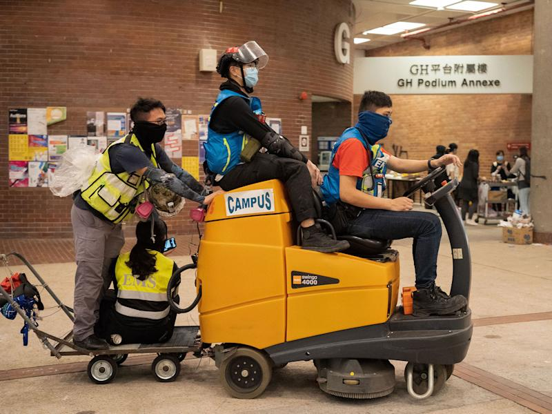 First-aiders convert a floor cleaning machine into a makeshift ambulance, Nov. 14. | Bing Guan