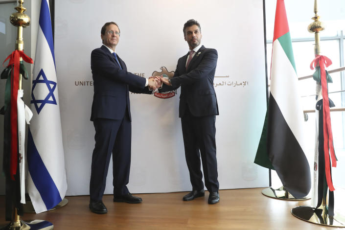 Israel's President Isaac Herzog, left, shakes hands with United Arab Emirates ambassador to Israel Mohamed Al Khaja during the opening ceremony for the new UAE Embassy in Tel Aviv, Israel, Wednesday, July 14, 2021. (AP Photo/Ariel Schalit)